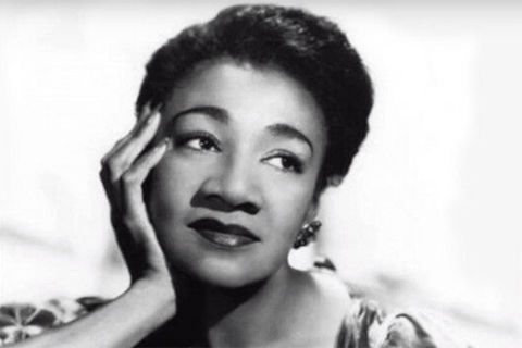 Alberta Hunter. Black and white photo of Black woman with chin in hand.