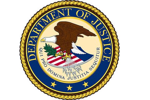 U.S. Department of Justice seal. Eagle perched on U.S. flag.