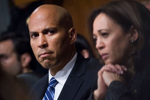 close-up of serious looking senators Cory Booker and Kamala Harris.