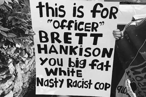 "Protest sign. ""This is for 'officer' Brett Hankison you fat white nasty racist cop."""