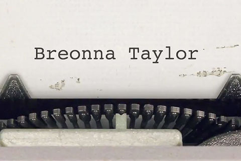 Breonna Taylor ad. Close up of typewriter keys and white page with the words: Breonna Taylor.
