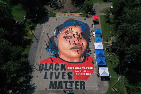 large mural on the ground of Breonna Taylor's face