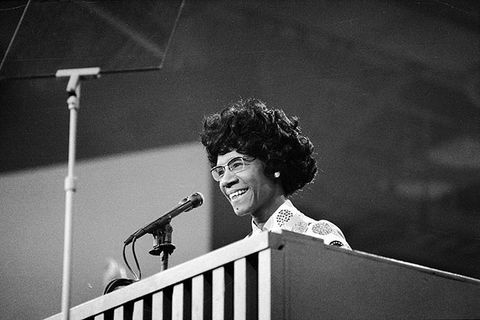 Shirley Chisholm. Black and white photo of Black woman with short curly hair at podium.