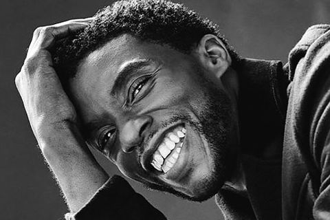 Chadwick Boseman. Black and white photo of Black man with short dark hair smiling.