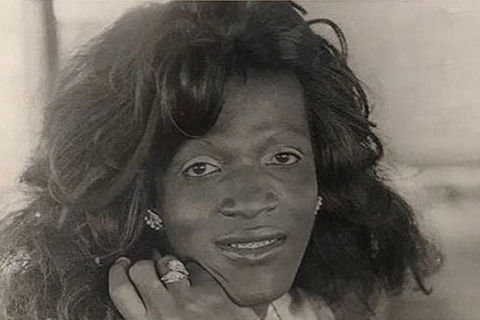 Marsha P. Johnson. Black and white photo of Black woman with long wavy hair.
