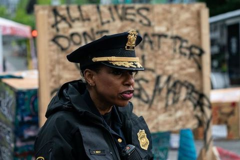 image of a Black woman in police uniform