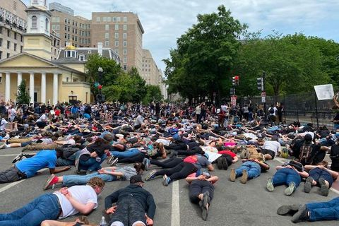 Protesters lie face down on a street near the White House.