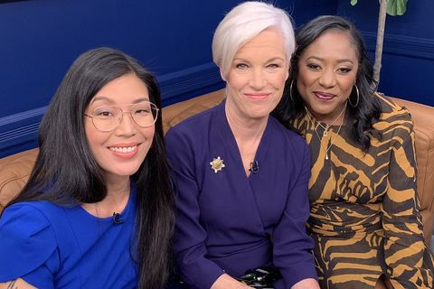 A trio of powerful Asian, white, and Black woman leaders pose on couch