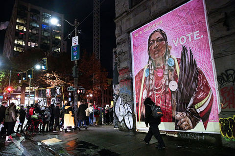 Native-American-Vote. Artwork on side of a building of Native American woman dressed in traditional attire.