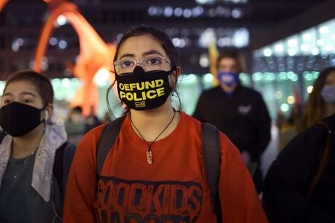 "Image of woman wearing ""defund police"" face mask"