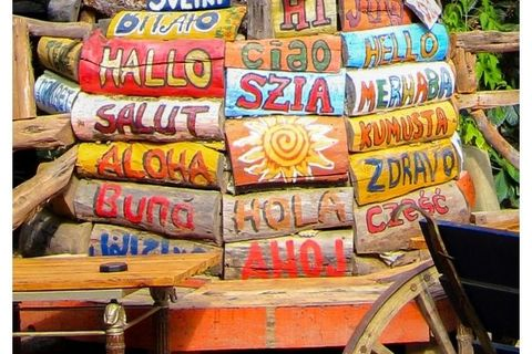"The word ""hello"" spelled out in different languages on brightly painted pieces of wood"
