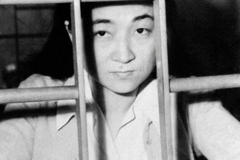 American born, Iva Toguri,  behind jail cell bars after being accused for treason