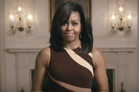 Michelle Obama in White House, brown dress, white furnishings in background