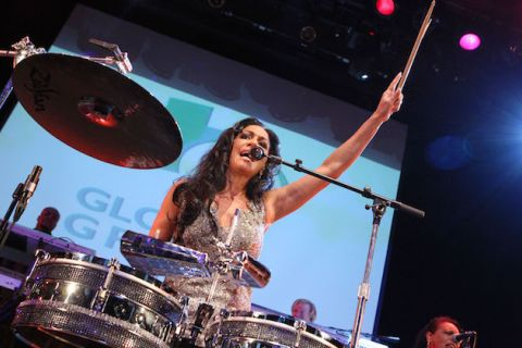 Sheila E. in sparkling silver dress behind timbales and percussion