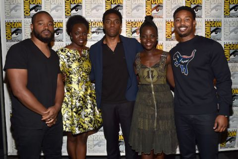Ryan Coogler in black shirt, Danai Gurira in yellow dress, Chadwick Boseman in black shirt with blue blazer, Lupita Nyong'o in brown dress, Michael B. Jordan in black crewneck