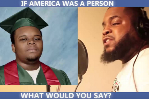 Mike Brown in green graduation cap and green and red robes, Crank Lucas in white shirt with brown background