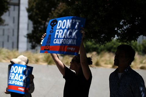 Protestors hold signs during a demonstration against fracking in California on May 30, 2013, in San Francisco, California.