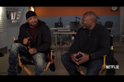 Method Man in black do-rag, black hoodie, blue jeans and maroon t-shirt next to Cheo Hodari Coker in black shirt and blue jeans