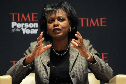 Anita Hill speaks on a stage, seated