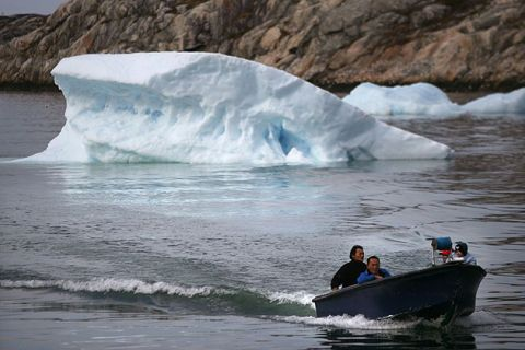 Inuit fishermen sail in their boat August 30, 2007, in the town of Ilulissat, Greenland. Greenland's Inuit population are the first to feel the effects of global warming.