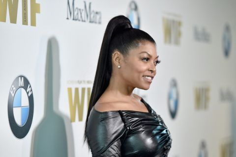 Taraji P. Henson in black leather dress with black ponytail against white background