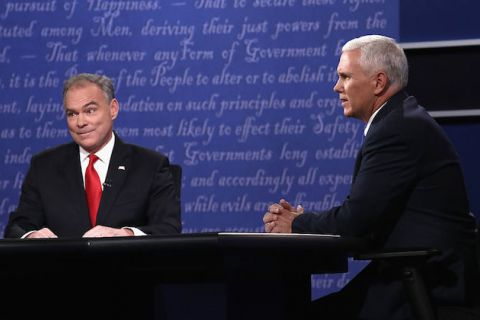 Tim Kaine looks incredulous as Mike Pence speaks.