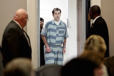 Michael Slager in white and gray striped coveralls and handcuffs