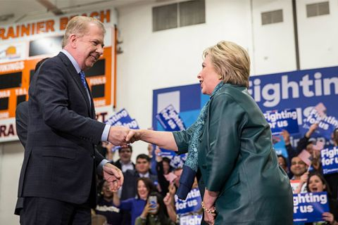 Seattle Mayor Ed Murray (left) shakes hands with Hillary Clinton, whom he had just endorsed, during a rally March 22, 2016, in Seattle, Washington. The mayor is standing with his city's status as a sanctuary city despite Donald Trump winning the election.