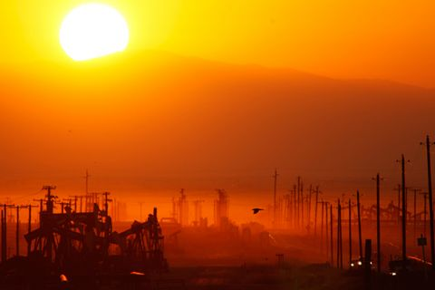 The sun rises over an oil field over the Monterey Shale formation in California where gas and oil extraction using hydraulic fracturing, or fracking, is on the verge of a boom on March 24, 2014. Voters in Monterey County just passed a ban on fracking.