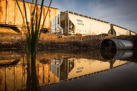 Train cars sit next to miles of unused pipe, prepared for the proposed Keystone XL pipeline, on October 14, 2014, outside Gascoyne, North Dakota. President Barack Obama rejected the pipeline in 2015, but president-elect Donald Trump wants to revive it.