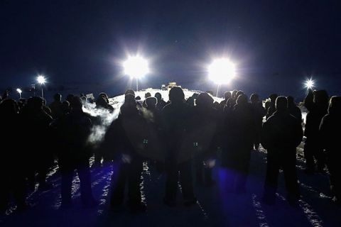 Military veterans, most of whom are Native American, confront police guarding a bridge near Oceti Sakowin Camp on the edge of the Standing Rock Sioux Reservation on November 30, 2016, outside Cannon Ball, North Dakota.