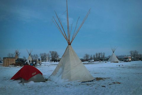 Snow covers the ground at Oceti Sakowin Camp on the edge of the Standing Rock Sioux Reservation on December 3, 2016, outside Cannon Ball, North Dakota. This camp is undergoing clean up while militarized police are raiding other camps.