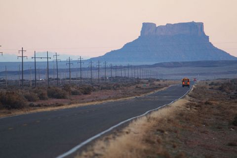 School buses carry children across the vast Navajo Nation south of Rock Point December 5, 2002, on the Navajo Indian Reservation, Arizona.