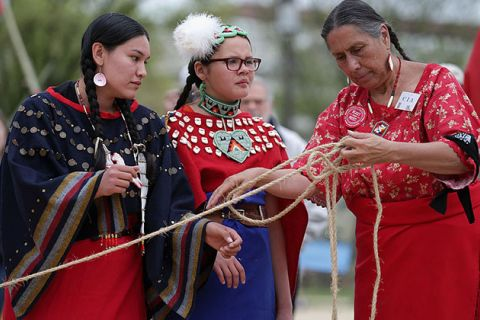 (L-R) Samantha Jones and Tashina Red Hawk of the Sicangu Lakota Band of the Rosebud Sioux Tribe from South Dakota and Casey Camp of the Ponca Nation help raise a large tepee as part of a demonstration against the Keystone XL pipeline on April 22, 2014.