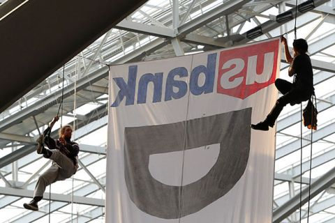 Two protestors hang suspended from ropes above the Minnesota Vikings and Chicago Bears football game on January 1, 2017, at U.S. Bank Stadium in Minneapolis, Minnesota. The protesters unfurled a banner in opposition to the Dakota Access Pipeline.
