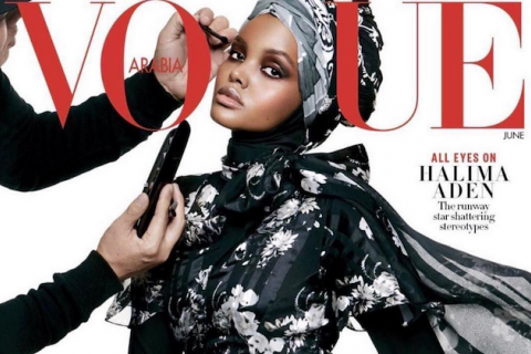 Halima Aden. Black woman wearing hijab on magazine cover.