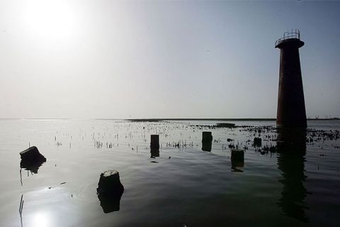 An abandoned lighthouse is seen surrounded by water in Plaquemines Parish August 3, 2006, near Venice, Louisiana.