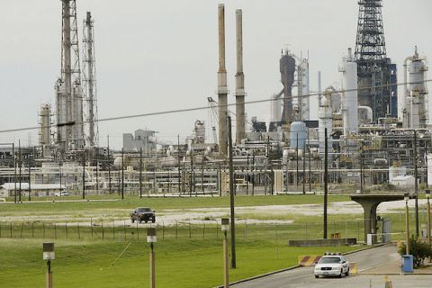 A security vehicle sits outside Exxon / Mobil refinery September 23, 2005 in Baytown, Texas.