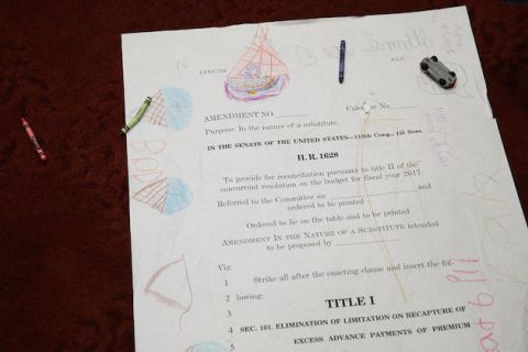 Children drawings are seen on an enlarged page one of the American Health Care Act of 2017