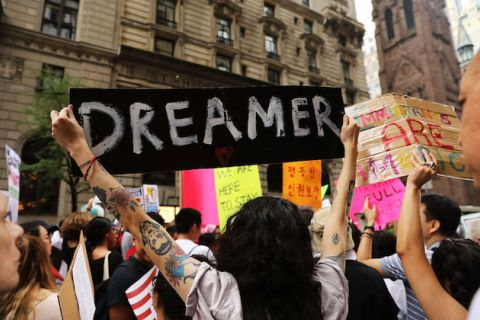 "Rally, someone holds up sign that reads, ""Dreamers."""