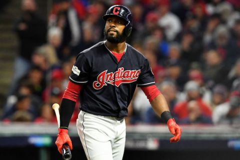 Black man with big beard in navy Cleveland Indians uniform