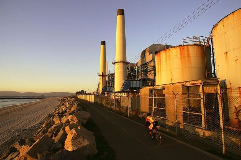 A cyclist passes the El Segundo Power Plant on November 29, 2006 in El Segundo, California.