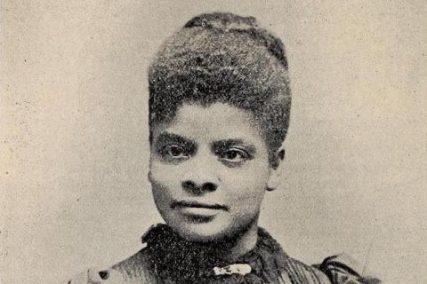 A black and white newsclipping of a Black woman wearing a lacy collar with her hair pulled back