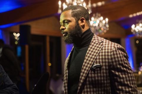 Michael Bennett. Black man in brown and tan checked blazer.