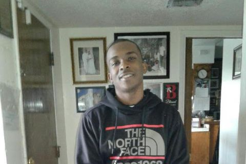 Stephon Clark. Young Black man in black, red and gray hooded sweatshirt