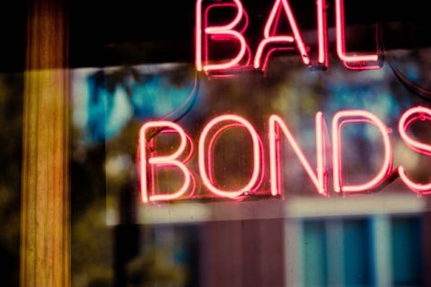 "Neon sign reads ""bail bonds."""
