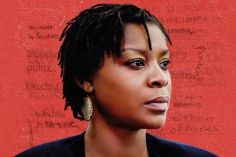 Sandra Bland. Black woman with black hair in black jacket in front of red background with dark red text