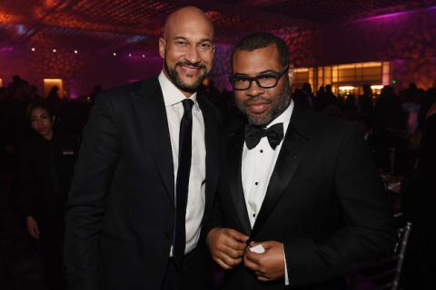 Keegan-Michael Key and Jordan Peele. Two Black men in black tuxedos and white shirts smile at the camera