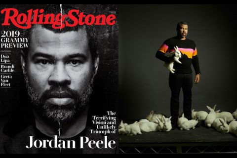 "Jordan Peele. Black-and-white magazine cover with Black man on black background behind white headlines and red text that spells ""Rolling Stone""; Black man in black and orange sweater and black pants holds white rabbit while surrounded by white rabbits"