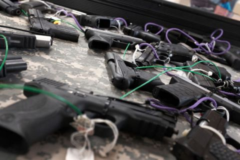 Close-up of several black guns displayed at a gun show in Naples, Florida on November 24, 2018.